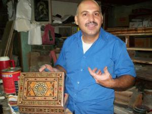 Elias in his then craft shop with the inlaid box he made and I bought for Steve, signed on the bottom by Elias.