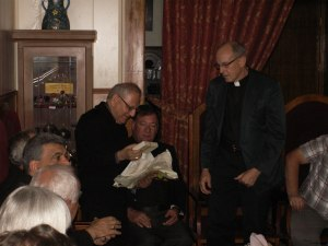 Msgr. Sako receives the cross from Rob Weingartner of The Outreach Foundation in Kirkuk, Iraq, November, 2012.