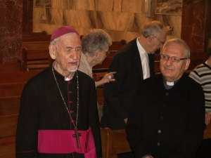 The then 93-year old former Chaldean Archbishop of Kirkuk chants in Syriac inside the sanctuary of the Chaldean Catholic Church in Kirkuk. Msgr. Louis Sako is on the right. (Nov. 2012)
