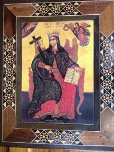 The icon of St. Tekla decoupaged on a wood inlaid frame.