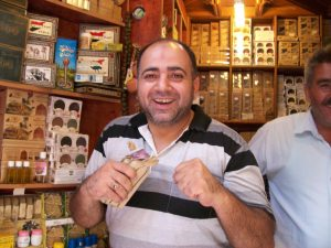 A soap merchant at the souk in Aleppo. This man was an Olympic wrestler.
