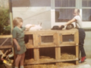 Heather and Susan with the bunnies and their hutch.