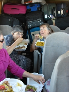 That's Kate and me in the back of the bus, eating our famous lunch of rice and lamb shanks with no utensils. Our job was to take care of the trash and hold up all those suitcases!