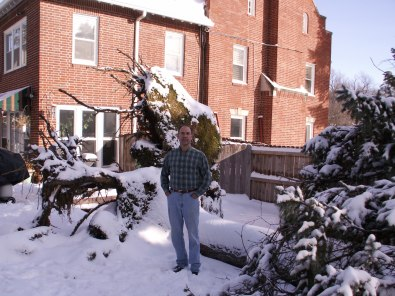 Steve standing by the root system of the pine tree, January 1, 2007.