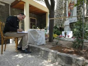 My friend Assis Salam Hanna at the grave of Fr. Frans van der Lugt in Homs, Syria, May, 2014.