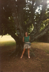 Cathy standing by a huge tree in Australia.