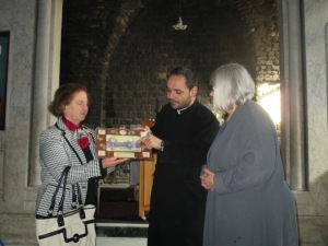 Fr. Ibrahim presents us with the gift of an icon at Notre Dame of the Belt, the Syrian Catholic Church in the old city of Homs, Syria.