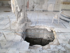 The crater left to the basement of Our Lady of Peace Melkite Catholic Church in Homs, Syria. This is where the pulpit used to be.