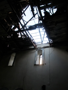 Cross-shaped hole in the roof of the National Evangelical (Presbyterian) Church of Homs, Syria.