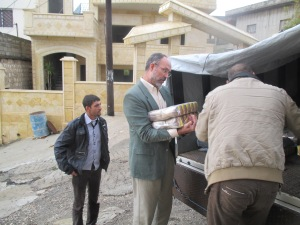 Steve helped unload the truck as it delivered the last three parts of the food parcels.