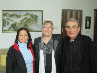 That's me, sandwiched between Huda and Rev. Michel Boughos of Yazdieh, Syria, in their home.
