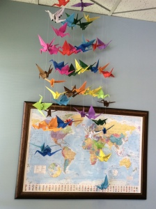 Paper cranes prayers ascending