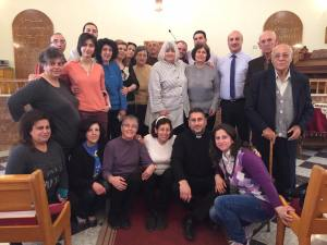 The Bloudan church elders and women's leaders on the chancel of the church. Assis Feras Ferah, who is pastoring the churches in Hasakeh, Kamishli and Malkieh in the northeast, is from this church. Many of these people are family to him. His mother is embraced by Marilyn Borst in the center.