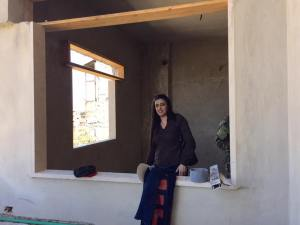 Michelline Koudmani in her Aunt' Mona's house which is currently under reconstruction.